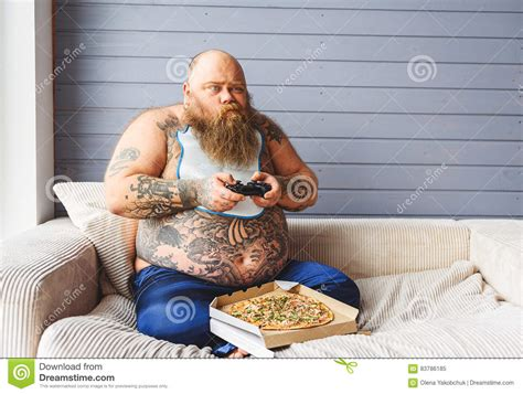 bbw on couch fat man entertaining at home stock image image 83786185