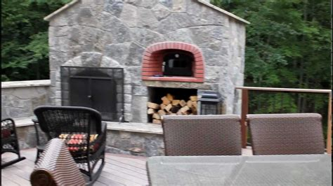 Outdoor Kitchen and stone fireplace with pizza oven built