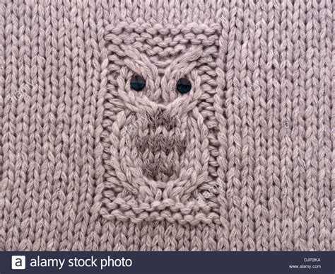 knitting pattern owl cushion hand knitted owl motif pattern on cushion cover in grey
