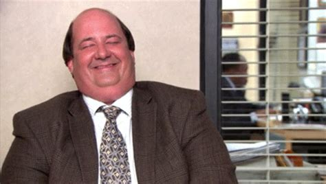 reaction gif tagged with laugh kevin malone brian