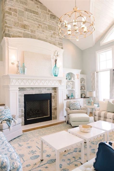light and airy living room with fireplace built ins vaul and light gray blue paint color quest