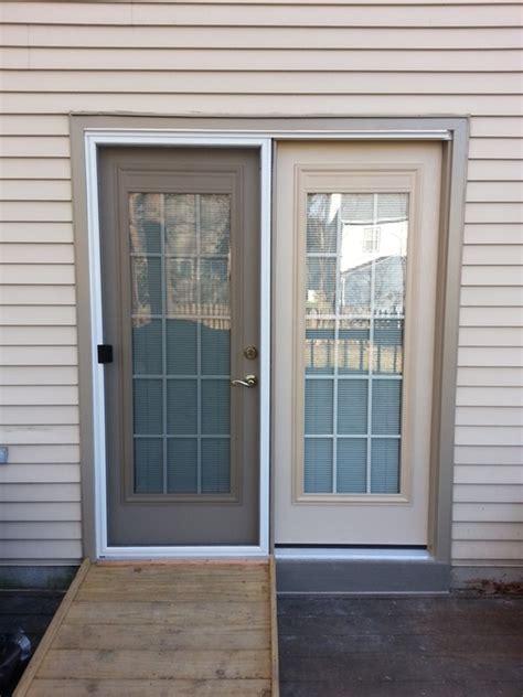 textured fiberglass patio door with blinds and grilles