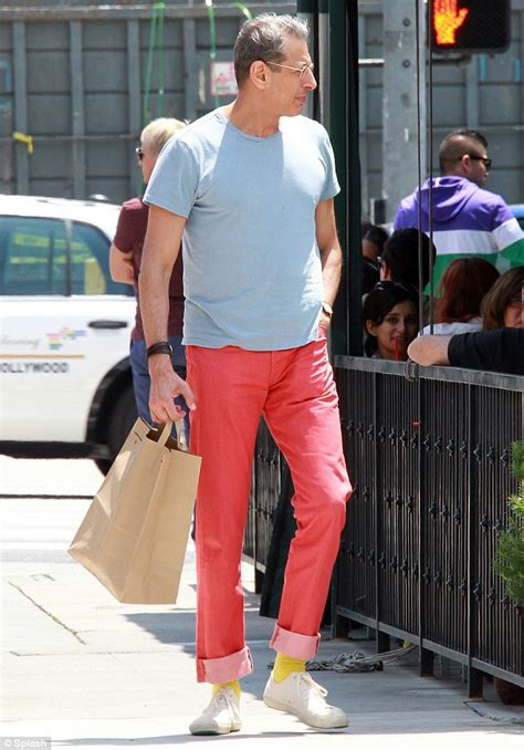 Fashion forward Jeff Goldblum, 60, mixes his colour palate as he stomps around in red pants and