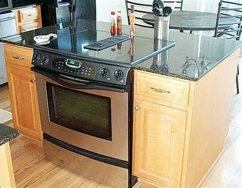 kitchen islands with slide in cooktop ovens