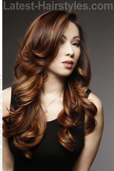 bouncy curly layered instruction haircuts long hairstyle with bouncy curls and balayage highlights