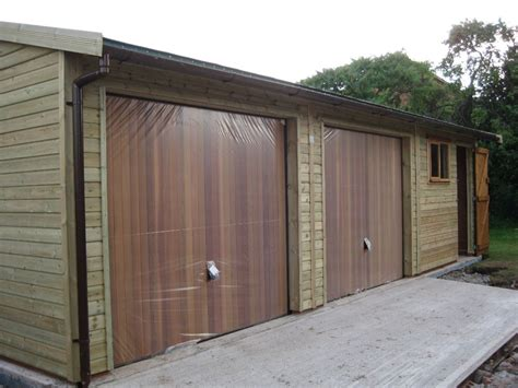 Cedar Clad Garage Doors by Warwick Garages Garage Building Garden Office Stables
