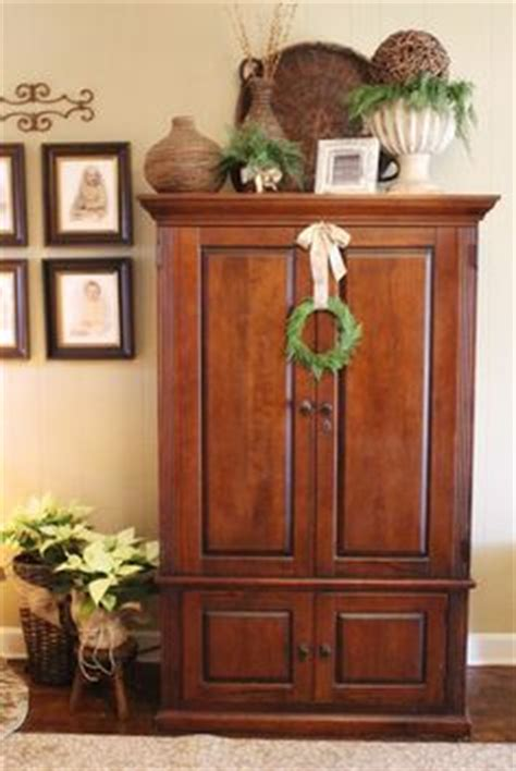 Decorating Armoire Tops by 1000 Ideas About Cabinet Top Decorating On