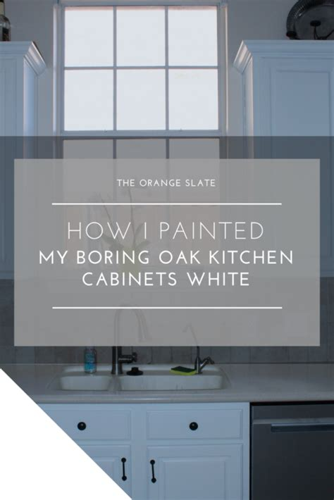 painting oak cabinets white how i painted my boring oak kitchen cabinets white the