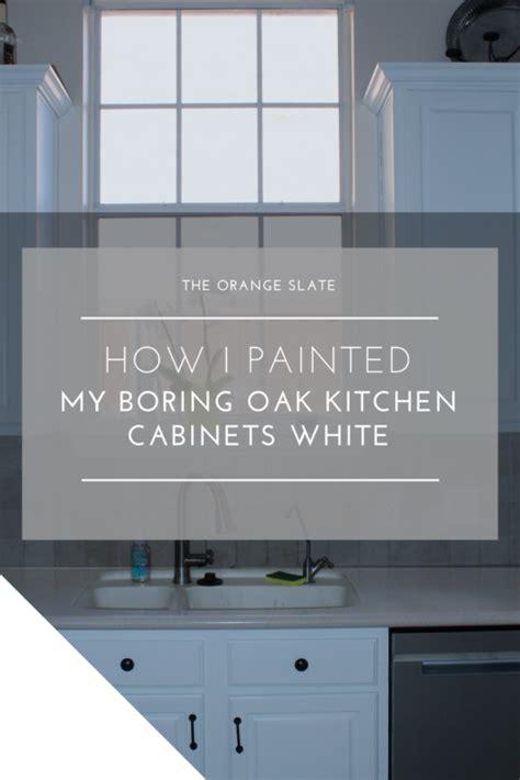 painting oak kitchen cabinets white how i painted my boring oak kitchen cabinets white the