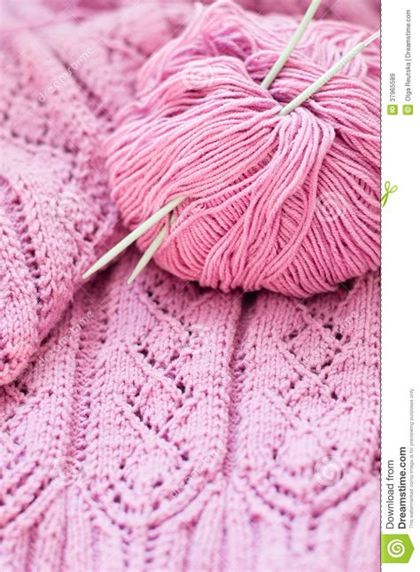 sweater pattern up close close up on pink detail of woven handicraft knit sweater
