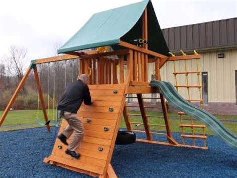rock climbing wall for swing set climb inside the supreme wooden swing set video for