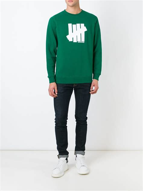 Jaket Zipper Hoodie Sweater Undefeated Logo undefeated logo print sweatshirt in green for lyst