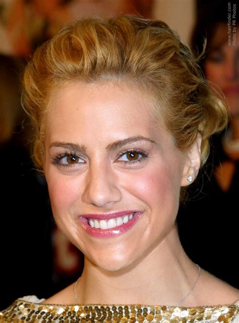 brittany murphy with blonde hair brittany murphy wearing her hair in an up do with a curly bun