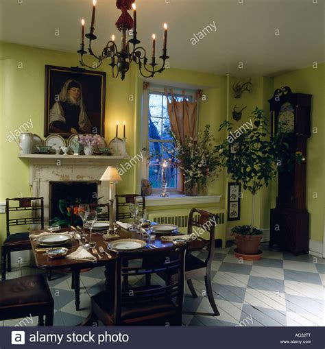 lime green dining room chandelier above antique table and chairs in lime green