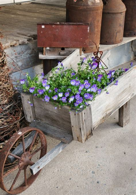 Rustic Wheelbarrow Planter by 25 Wheelbarrow Planter Ideas For Your Garden Garden