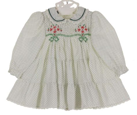 Polly flinders white dotted smocked dress with tiers of ruffles polly flinders white dotted