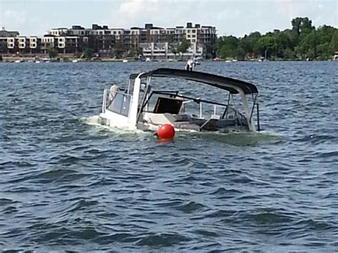 sinking boat lake water patrol rescues occupants of sinking boat lake