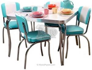 Chrome and vinyl chairs and chrome legged tables with formica tops