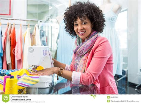 design clothes sewing fashion designer with sewing machine stock photo