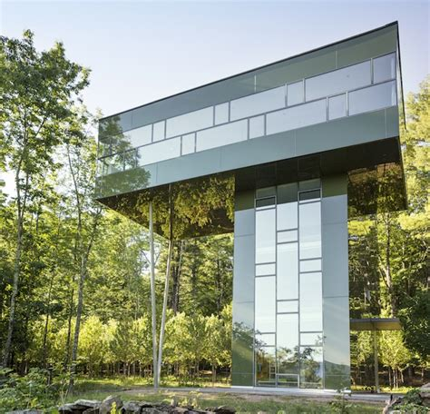 big tower tiny square an amazing glass house that peeks over the forest wired