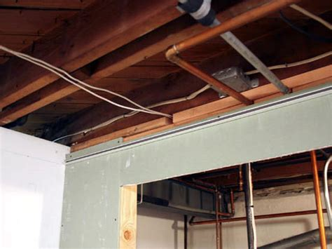 Low Clearance Drop Ceiling by Installing A Drop Ceiling In A Basement Laundry Interior