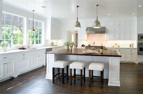 white kitchen island with stools slipcovered bar stools traditional kitchen