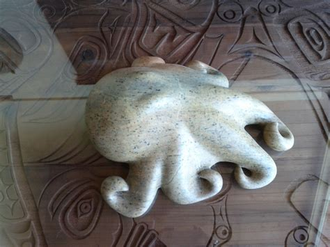 carving soapstone this is a craved soap octopus on a carved teak