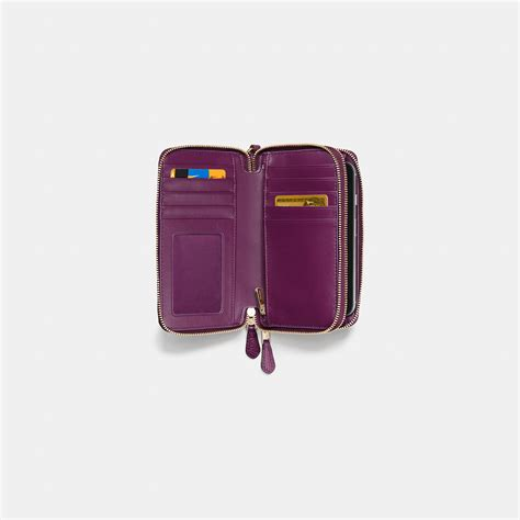 Purple Accessories Purple Wallets Purple Belts Purple Gloves And More by Lyst Coach Zip Phone Wallet In Floral Print