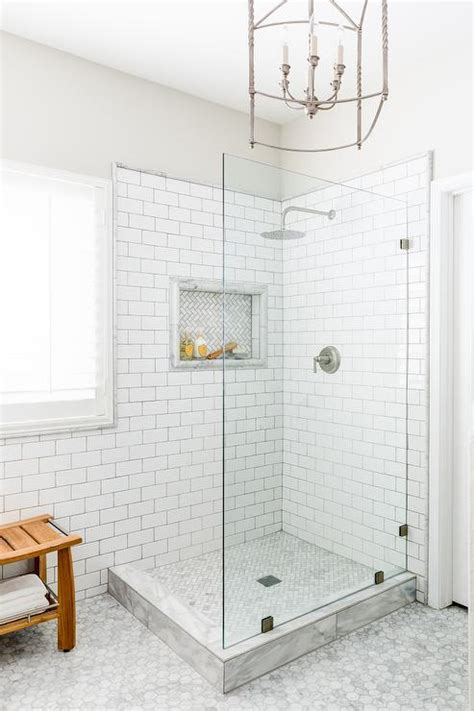 Ballard Design Lighting corner shower with seamless glass partition transitional