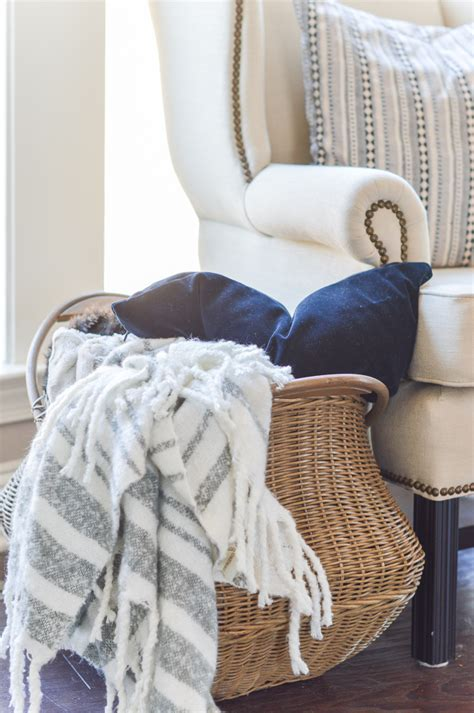 throw pillow storage 11 ways to use baskets for storage and decor in your home