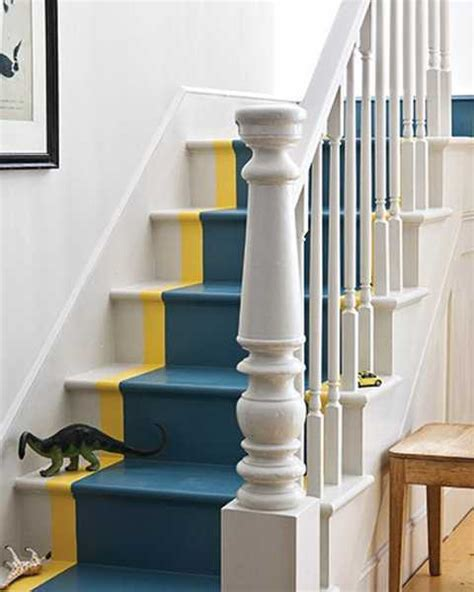 wooden stairs  painted stripes updating interior