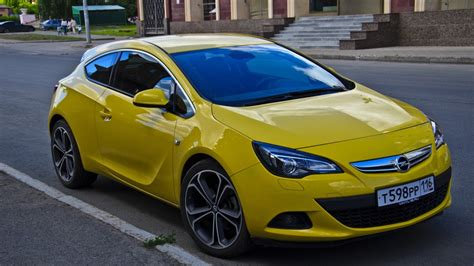 opel yellow opel astra gtc yellow badass owner review drive2
