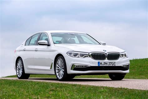 bmw  series hybrid review trims specs  price