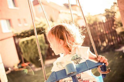girl on a swing little girl on a swing