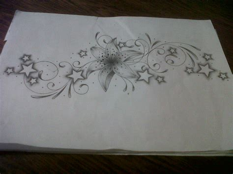 lily and stars tattoo designs design with swirls and by tattoosuzette