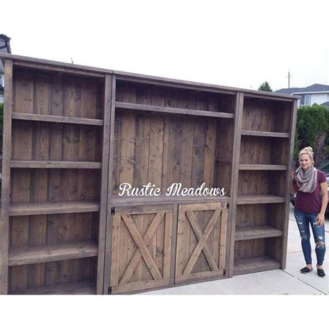 barn door media cabinet amazing rustic planked wood barn door media wall home