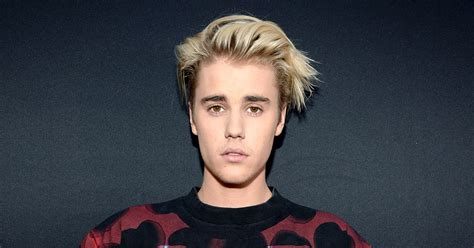 justin beiber face tattoo justin bieber s artist explains its meaning