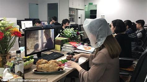 Roasts Whole Chicken At Desk In Office
