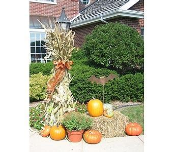 Fall Decorating with hay bales, pumpkins, mums, and corn
