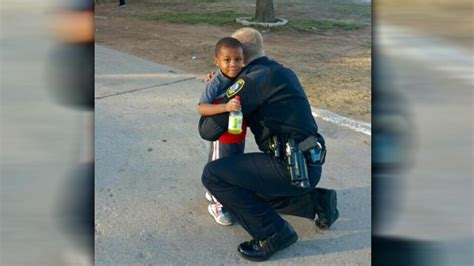 boy requests hug from officer officer fulfills