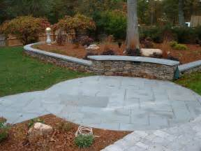 the patio and walkway are pennsylvania sawed blue flagstone the wall is pennsylvania chopped