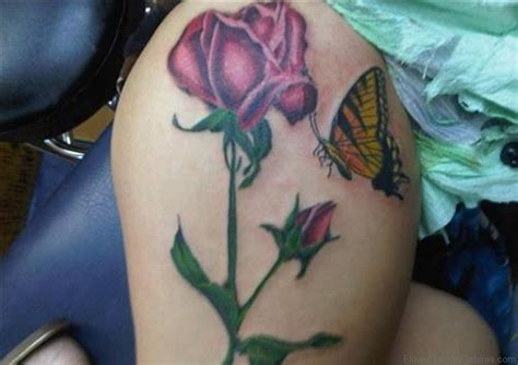 rose tattoo with butterfly 68 phenomenal tattoos on thigh