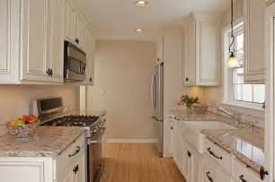 white kitchen stainless appliances farmhouse kitchen sink granite countertops white