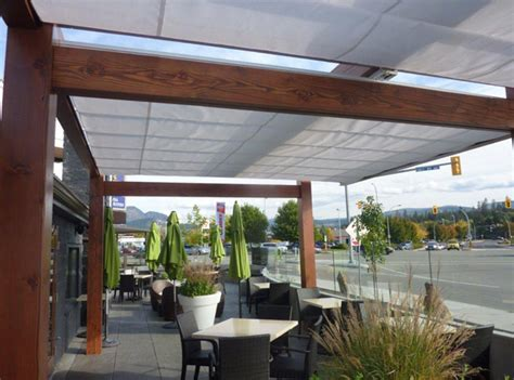 outdoor awnings and canopies get retractable canopy to cover the patio decorifusta