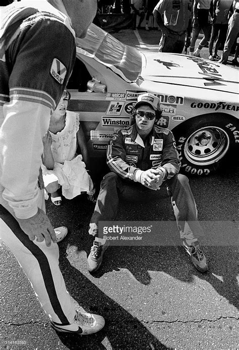 NASCAR driver Dale Earnhardt and Buddy Baker exchange some