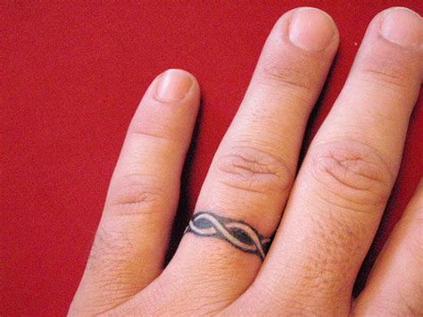 infinity tattoo ring designs 110 best wedding ring tattoo ideas images on pinterest