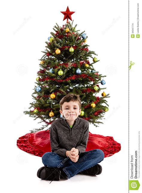 child in front of christmas tree stock images image