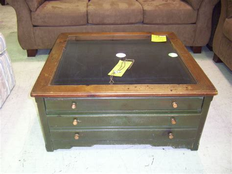 Glass Top Display Coffee Table With Drawers Brown Leather Table With Four Storage The Counter Top Placed On The White Rug