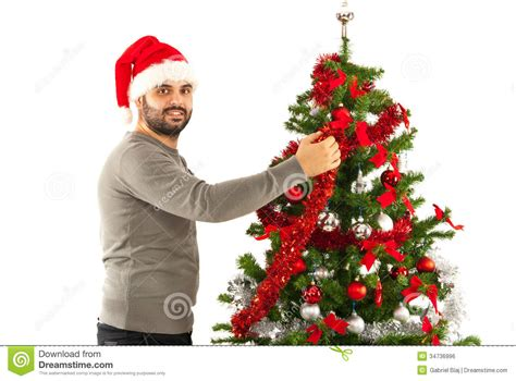 man with santa hat decorate tree royalty free stock image