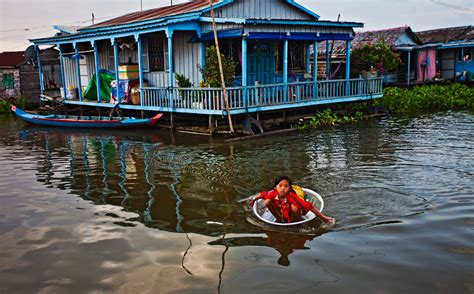boat big enough to live on photographing life on the water at tonle sap lake